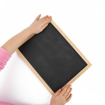Child hands touching empty blackboard isolated on white top view with copy space