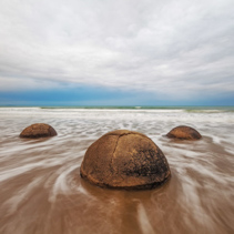 Famous Moeraki Boulders at sunrise and long exposure, Koekohe beach,Otago, South Island, New Zealand