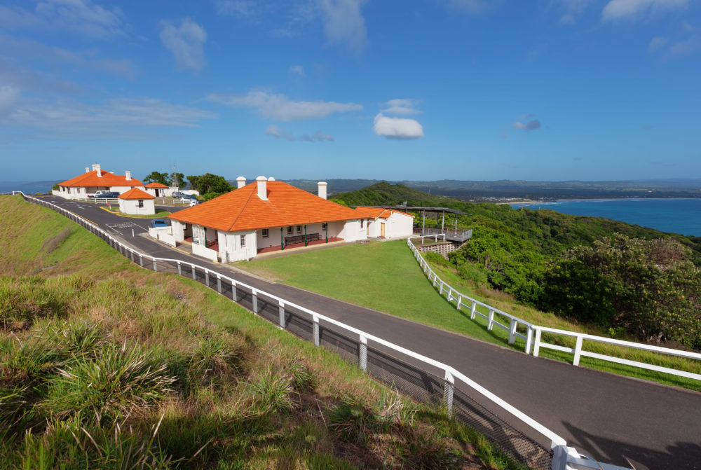 Picturesque red-roofed houses near Cape Byron Lighthouse at Byron Bay, NSW, Australia