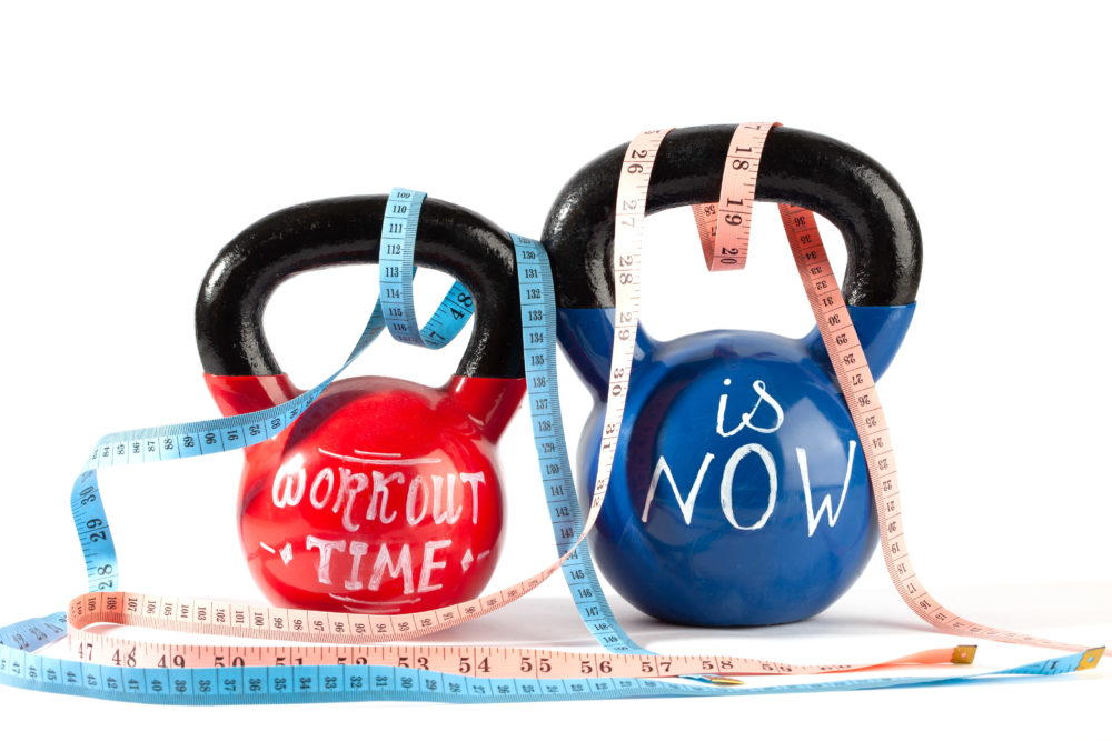 Red and blue kettlebells with Workout time is now lettering
