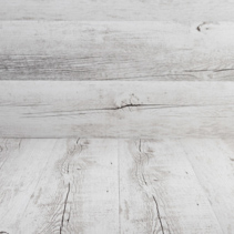 White rustic wooden background for product placement