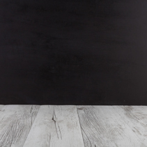 White rustic wood table with black background. Horizontal image with copy space