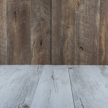 White rustic wooden table with brown wood background and copy space
