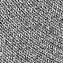 Jute braided home spiral rug background texture pattern - close-up