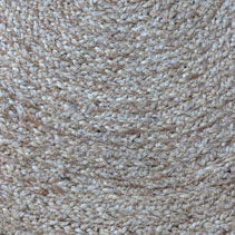 Jute braided spiral rug texture background clos-up