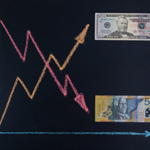 Forex currency trends concept - USD going up while AUD going down. Depicted with chalkboard line graphs and paper currency.