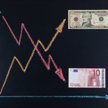 Forex currency trends concept - EUR going down while USD going up. Depicted with chalkboard line graph and paper currency.