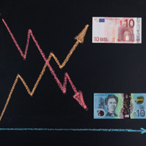 Forex currency trends concept - AUD going down while EUR going up. Depicted with chalkboard line graph and paper currency.