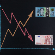 Forex currency trends concept - EUR going down while AUD going up. Depicted with chalkboard line graph and paper currency.