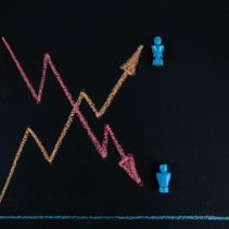 Gender equality concept - line graph hand drawn with chalk on blackbloard with male and female figurines and copy space