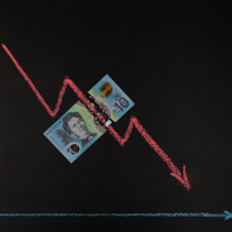 Currency forex trends market concept - decreasing trend depicted with line graph pointing down drawn with chalk on blackboard and 10 Australian dollars bill with copy space