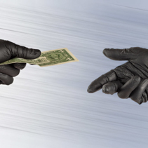 Hands in gloves exchange one american dollar