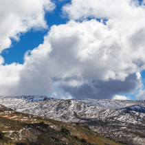 Beautiful fluffy clouds over Snowy Mountains at Mount Kosciuszko
