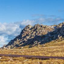 Mount Kosciuszko summit walk and beautiful rocks on bright sunny