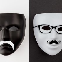 Black mask on white and white mask on black. Identity change concept.