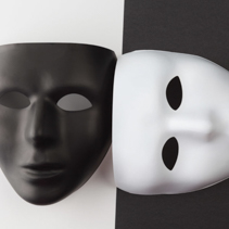 Black and white masks without expression at different angles.
