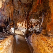 Walking path among stalactites and stalagmites in a cave in Australia