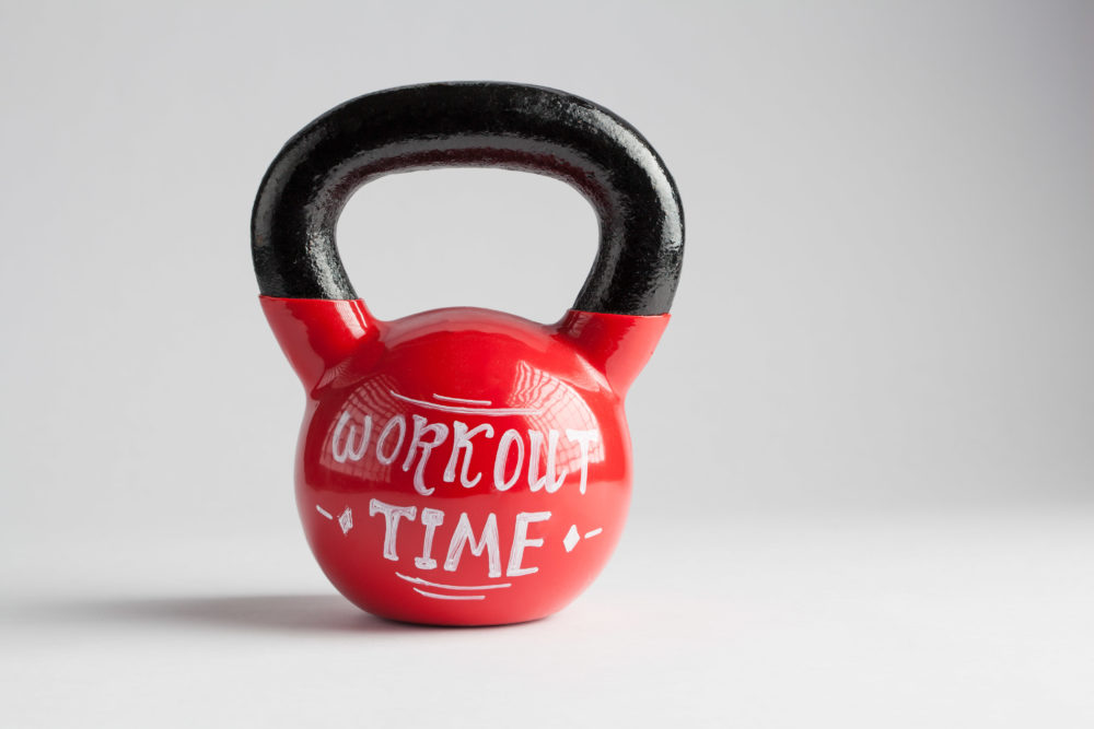 Red kettlebell with Workout Time lettering written on it isolated on white