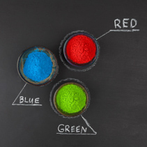 RGB color scheme concept depicted with colorful dyed powder on chalkboard