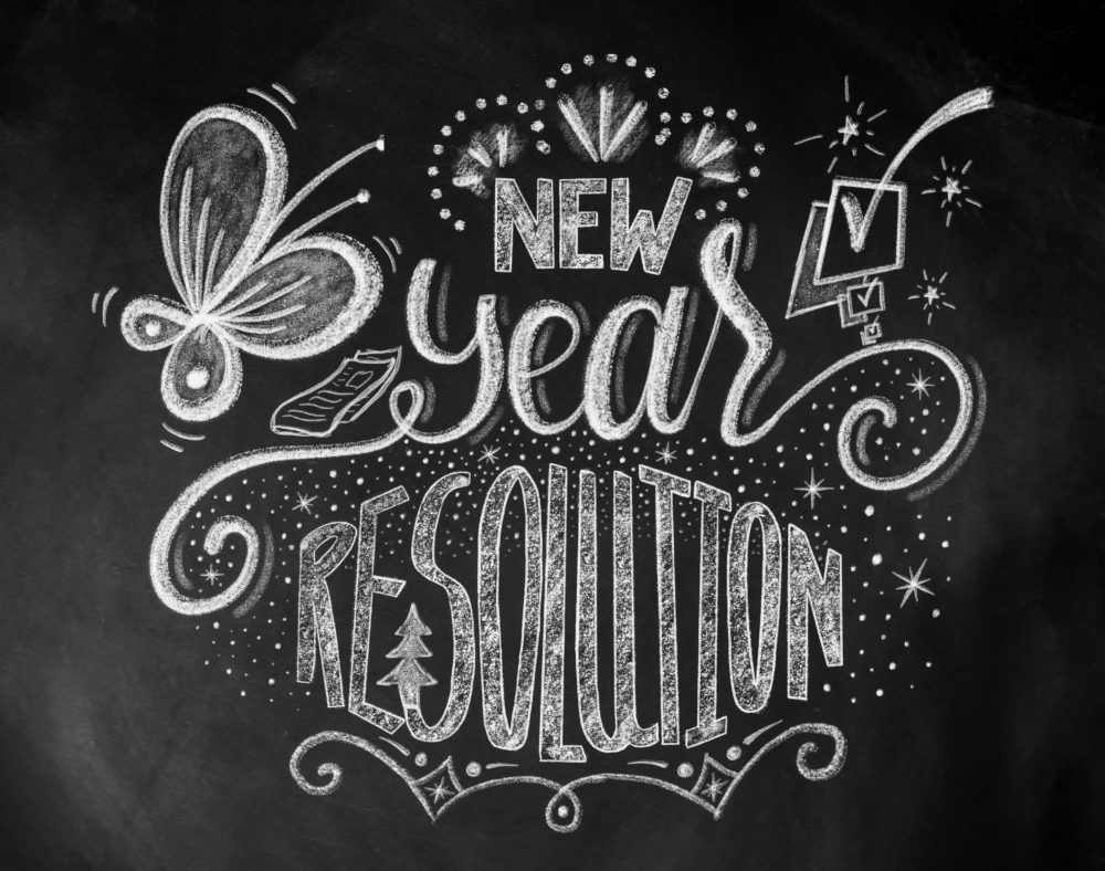 New Year Resolution hand lettering design with chalk on blackboard