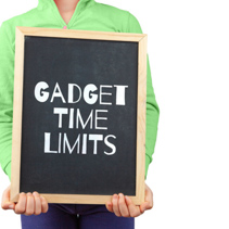 Gadget time limits for children subject depicted with child holding blackboard with text and copy space