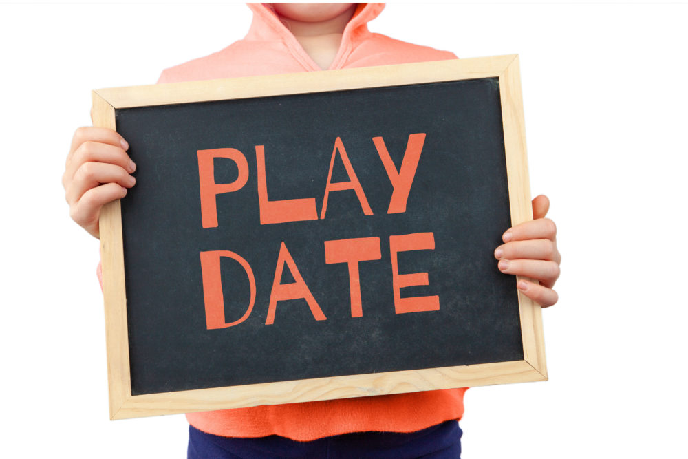Play Date subject depicted with child holding blackboard with text
