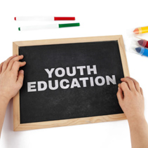The topic of youth education depicted with child hands and blackboard with text